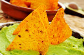 Nachos and guacamole — Stock Photo