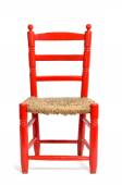 Old red wicker chair — Stock Photo