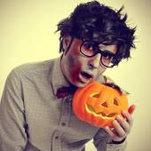 Hipster zombie with a jack-o-lantern, with a retro effect — Stock Photo