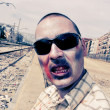 Scary zombie with sunglasses at abandoned railroad tracks, with — Stock Photo #54978713