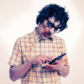 Scary hipster zombie using a tablet computer, with a filter effe — Stockfoto