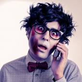 Hipster zombie talking on the phone, with a retro effect — Stock Photo