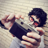 Hipster zombie taking a selfie, with a retro effect — Stock Photo