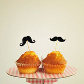 Moustaches in cupcakes, with a retro effect — Stock Photo