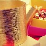 Boxes, golden ribbons and ribbon bows — Stock Photo #57552413