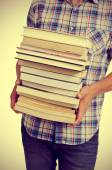 Young man with books, with a filter effect — Stock Photo