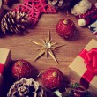 Christmas gifts and ornaments on a rustic wooden table — Stock Photo #57770183