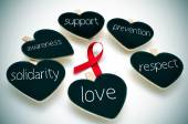Red ribbon for the fight against AIDS — Stock Photo