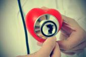 Doctor auscultating a heart with a stethoscope, with a retro eff — Stock Photo