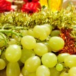 Grapes, champagne and gifts — Stock Photo #58452781