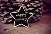 Felices fiestas de texto en una pizarra en forma de estrella, en negro y wh — Foto de Stock