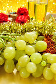 Grapes, champagne and gifts — Stock Photo
