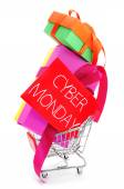 Gifts in a shopping cart and signboard with the text cyber monda — Stock Photo