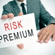 Businessman with a signboard with the text risk premium — Stock Photo #59118851