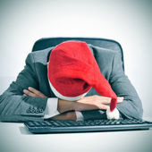 Man sleeping in the office after a christmas party — Stockfoto
