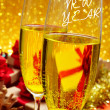 Glasses with champagne and the sentence happy new year — Stock Photo #59560901