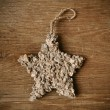 Rustic christmas star on a wooden surface — Photo #59659327