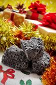 Candy coal and christmas gifts — Stock Photo