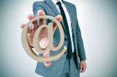 Businessman with an at sign — Stock Photo