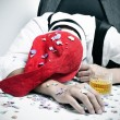 Man sleeping in the office after a christmas party — Stock Photo #60122023