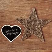 Seasons greetings written in a heart-shaped chalkboard — Stock Photo