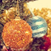 Baubles on a christmas tree, with a filter effect — Stock Photo