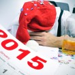 Man sleeping in the office after a new years party — Stock Photo #60836247