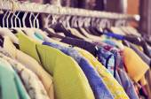 Clothes hanging on a rack in a flea market — Stock Photo