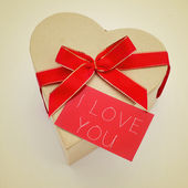 Heart-shaped gift box and signboard with the text I love you — Stock Photo