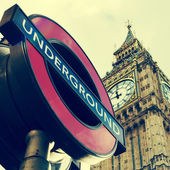 Underground sign and the Big Ben in London, United Kingdom, with — Stock Photo
