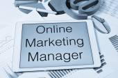Text online marketing manager in the screen of a tablet — Stock Photo