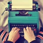 Young man typewriting, with a retro effect — Stock Photo