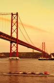 25 de Abril Bridge in Lisbon, Portugal, with a filter effect — Stock Photo