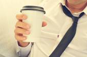 Man drinking coffee in a paper cup — Stock Photo