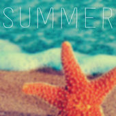 Word summer and a starfish in the seashore — Stock Photo
