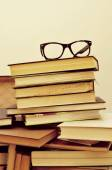 Books and eyeglasses in an old suitcase — Stock Photo