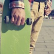 Young man with a skateboard — Stock Photo #66994641