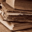 Old books on a rustic wooden table — Stockfoto #68735183