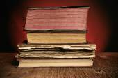 Old books on a rustic wooden table — Stock Photo