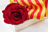 Book, red rose and the catalan flag for Sant Jordi, Saint George — Stock Photo