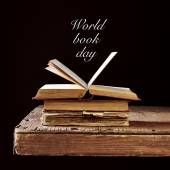 Some old books and the text world book day — Stock Photo