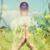 Yogi man in meditating outdoors — Stock Photo