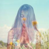 Double exposure of a young woman meditating and a peaceful lands — Stock Photo