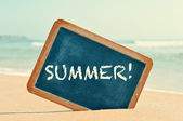 Word summer in a chalkboard, on the sand of a beach — Stock Photo