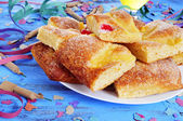 Streamers, firecrackers and coca de Sant Joan, typical sweet cak — Stock Photo