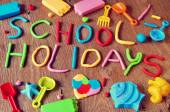 Text school holidays made from modelling clay — Stock Photo