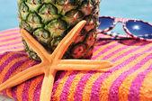 Starfish, beach towel, pineapple and sunglasses — Stok fotoğraf