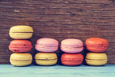 Macarons on a blue rustic surface, cross processed — Stock Photo