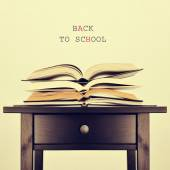 Open books on a table and text back to school, with a retro effe — Stock Photo