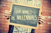 Text our name is the millennials in a chalkboard — Stock Photo